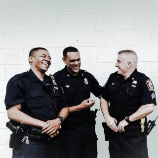 Spring Valley police officers share a moment of levity