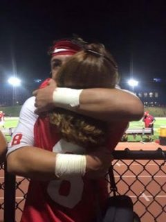North Rockland Red Raiders QB Dylan Senatore hugs his mother following the team's crucial 28-20 victory over rival Suffern. The contest was close throughout but the Red Raiders held on to win in the end.  Photo by Janet Guerra