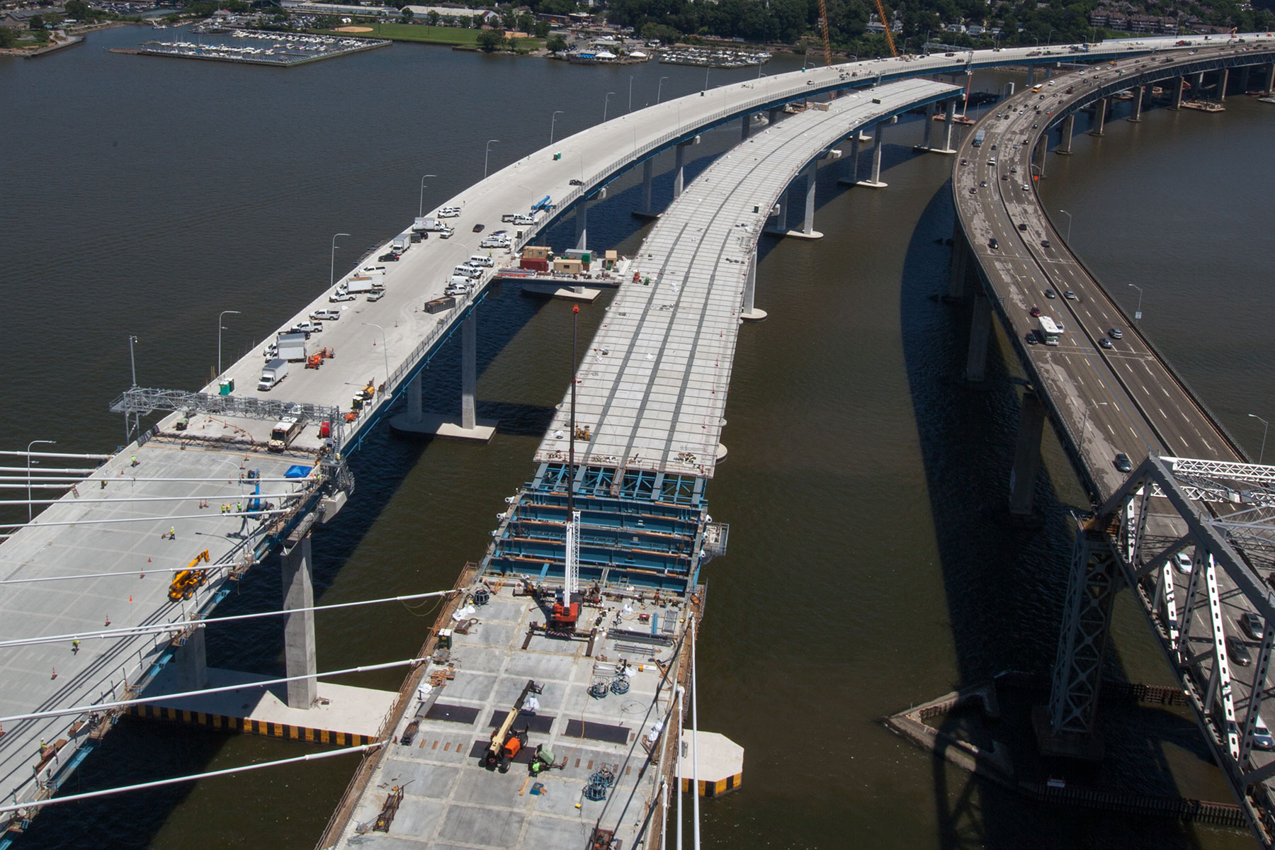 Crews working on eastbound span, final prep for westbound span opening