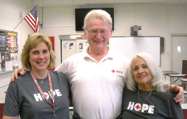 UNSUNG HEROES: Linda McMullan, Brian McMullan and Nanci Banninger, Members of the Red Cross Disaster Action Team (DAT)