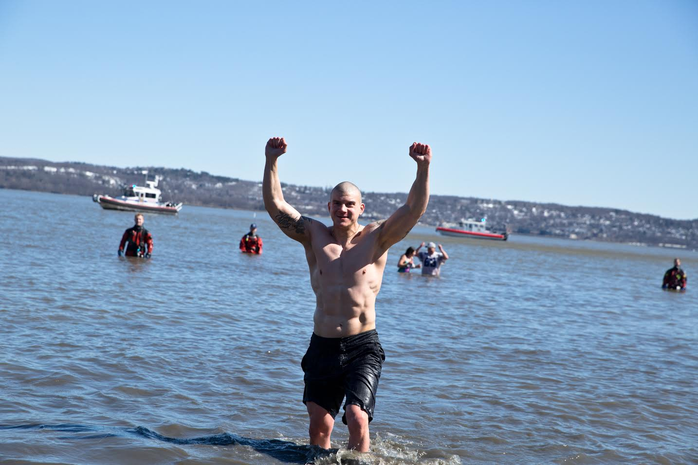 WHO SAYS IT'S COLD? POLAR SWIMMERS STAY WARM BY OPENING THEIR HEARTS TO CHARITY