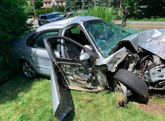 Man crashes car, flees, arrested